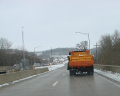 Salt Trucks On a Snowy Day