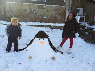 Zoe & Axl's snow penguin