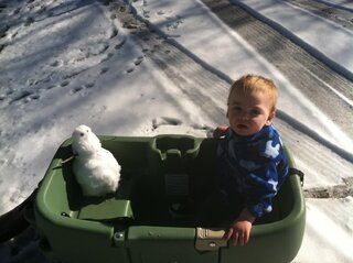 Kason's Baby Snowman on His Last Ride!