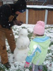 Daddy helping build Snowman