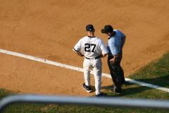 Joe Girardi disputes call, but Yanks win