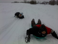 sledding down a slippery slope
