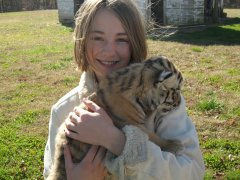 Annika and a baby tiger cub