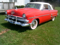 We have a cool car. A1953 Ford sunliner