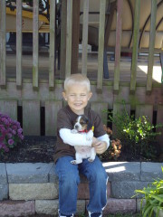 oakley and his puppy at grandma's