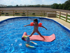 Madelynn surfing at the pool