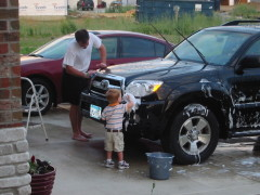 Cooper helping daddy wash the car!