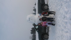 A snowman larger than a pickup truck