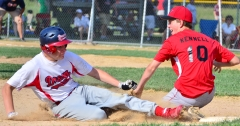 Tagged out sliding into 3rd base