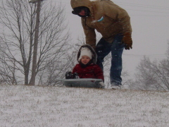 Sledding with Grandpa for the first time