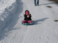 Karstyn loving her new sled & the snow
